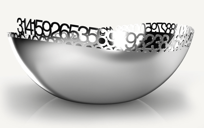 The Pi Collection Salad Bowl with a mirrored stainless steel finish. The number pi is cut out and runs along the edge of the bowl before gradually sinking below the wavy edges.