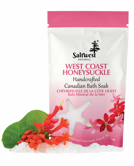 70 grams of West Coast Honeysuckle bath soak in a white and pink standing bag.
