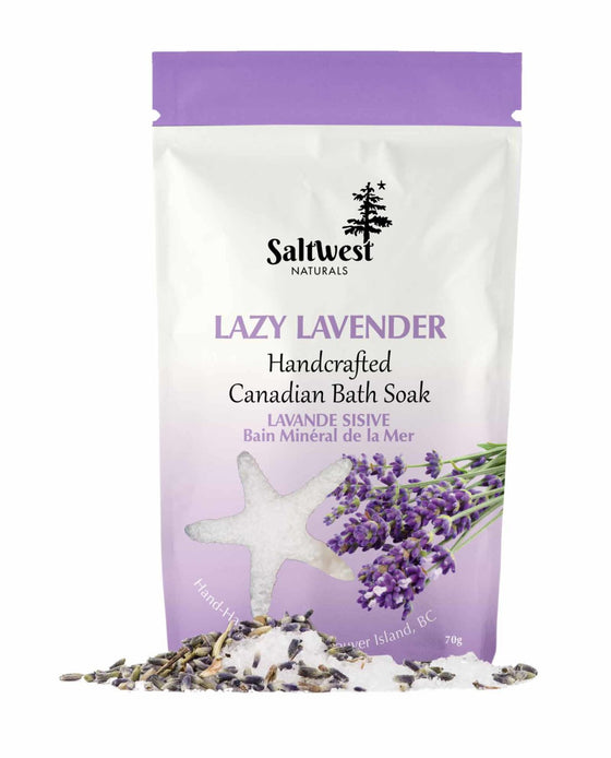 70 grams of Lavender bath soak in a white and purple standing bag.