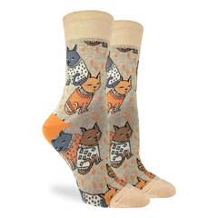 These fun socks feature grey, orange, and brown cats wearing white and orange patterned sweaters. The cats sit on a tan coloured background with a lighter tan toe and rim, and an orange heel. Spandex added to the 85% cotton blend gives the socks the perfect amount of stretch to hug your feet.