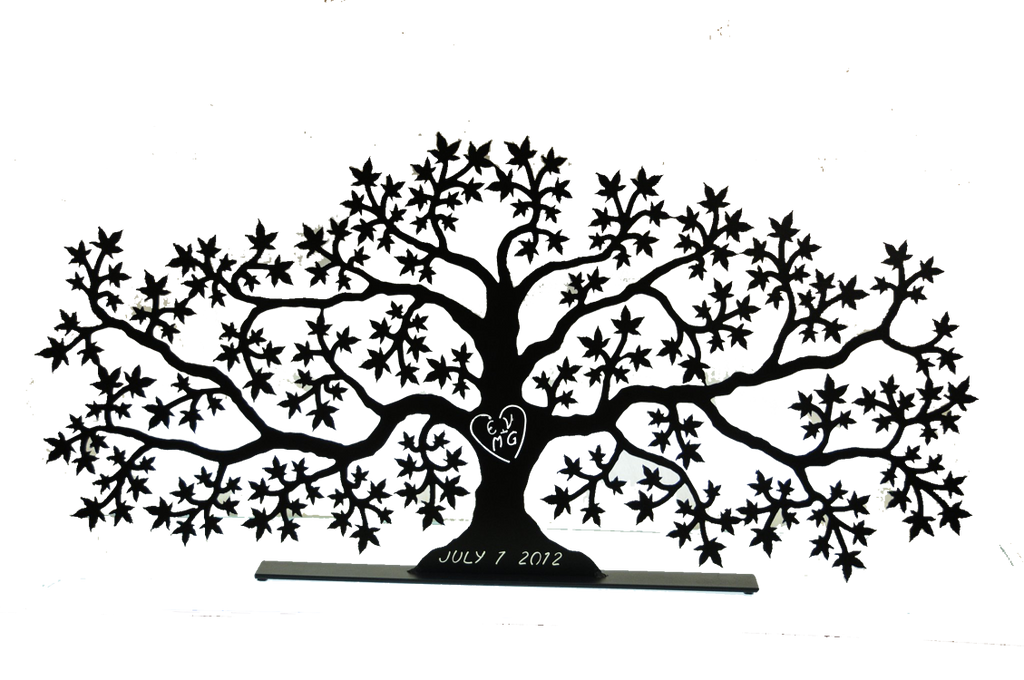 "This metal sculpture shows the matte black silhouette of a sprawling maple tree, twice as wide as it is tall. Half way up the tree's trunk the initials ""EV + MG"" have been carved through the metal, allowing light to pass though the sculpture. The initials are enclosed by a heart. At the base of the trunk is carved ""July 1, 2012"". The piece sits on a narrow, rectangular base."