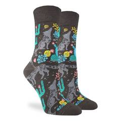 These fun socks feature wolves walking and howling, surrounded by blue, red, and yellow abstract floral designs on a brown background. Spandex added to the 85% cotton blend gives the socks the perfect amount of stretch to hug your feet.