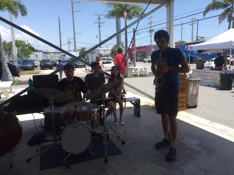 rane playing saxophone at the market