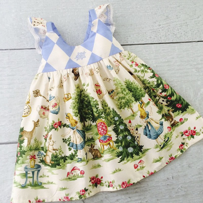 This adorable vintage inspired fabric Alice in Wonderland dress is a must have for all you Disney fans! The lace eyelet detailing on the sleeves adds to that retro vintage vibe.