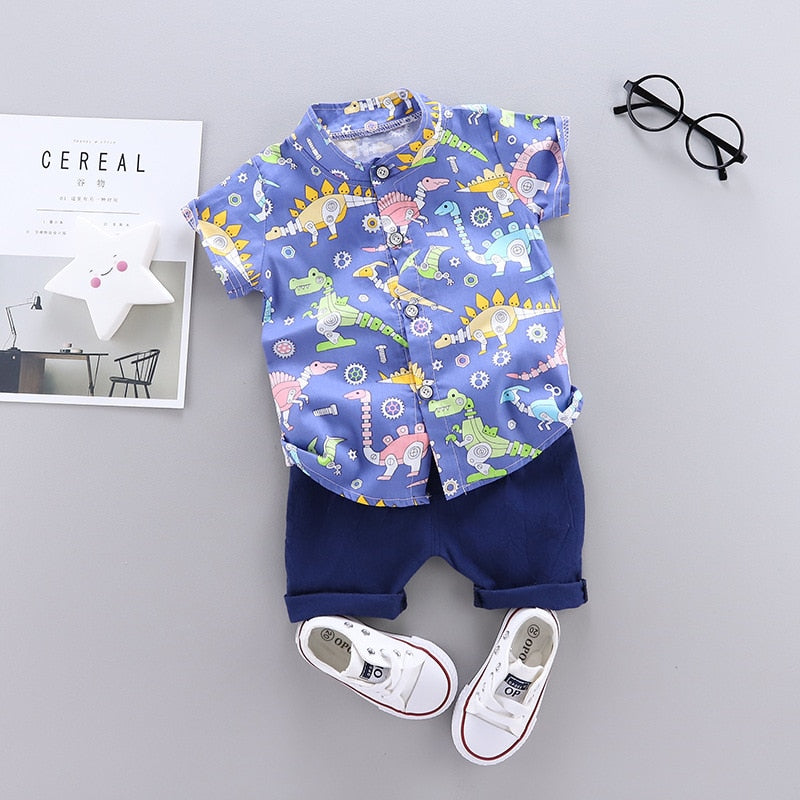 What little boy does not like dinosaurs? We love this adorable collar shirt printed with dinosaurs and its matching shorts. We are suckers for adorable baby and toddler boy button up shirts.