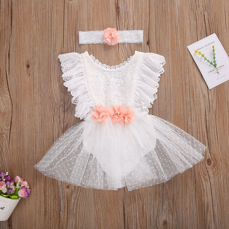 This little dress romper with white lace and peach rhinestone flowers is just the sweetest little baby girl outfit we have ever seen. The matching flower headband is the icing on the cake. Your little one will be picture perfect in her tutu skirt romper with little ruffle sleeves and lace eyelet detailing.