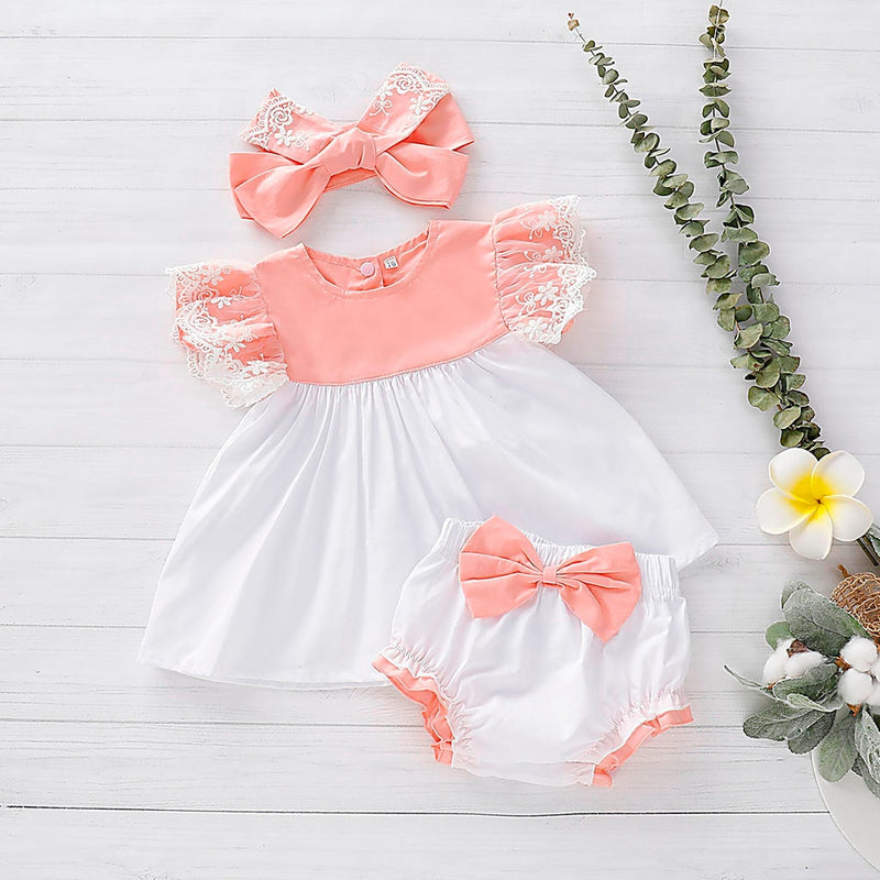 These colors are giving us all the feels. We love the peach and white lace dress with matching bloomers set and of course the matching headband just ties it all together. The colors make us think of sunshine and spring and summer time even though this can totally be worn year round.