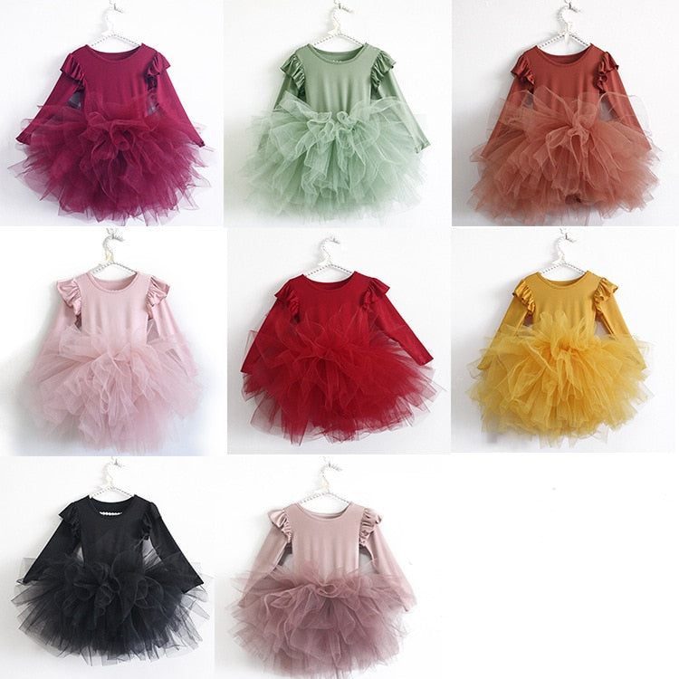 These leotard style girls tulle tutu dresses are adorable for everyday wear, dance class or even dance recitals! Our customers love to use them for dress up too! We love the long sleeves and ruffle details that give it that little something extra! girls long sleeve tutu dress with tulle skirt