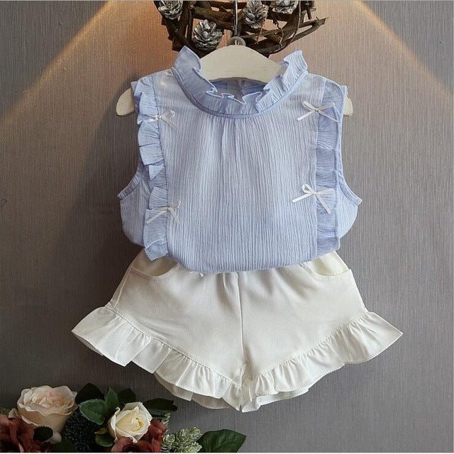 3751e8d86be ... Baby Girl Summer Outfit with Denim Pearl Skirt and Eyelet Top ...