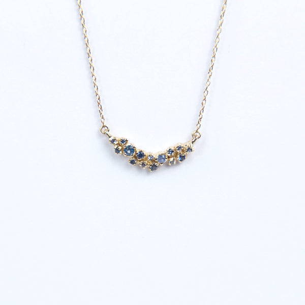 N + A Jewelry: Curved Cluster Blue Sapphire Necklace