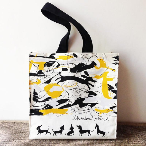 Black, yellow and white tote bag with Dachshunds admiring art