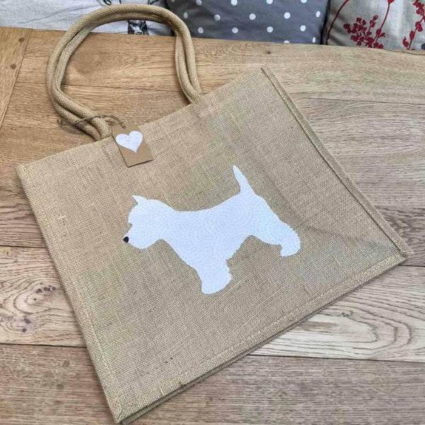 Brown jute bag with white fabric westie in the centre