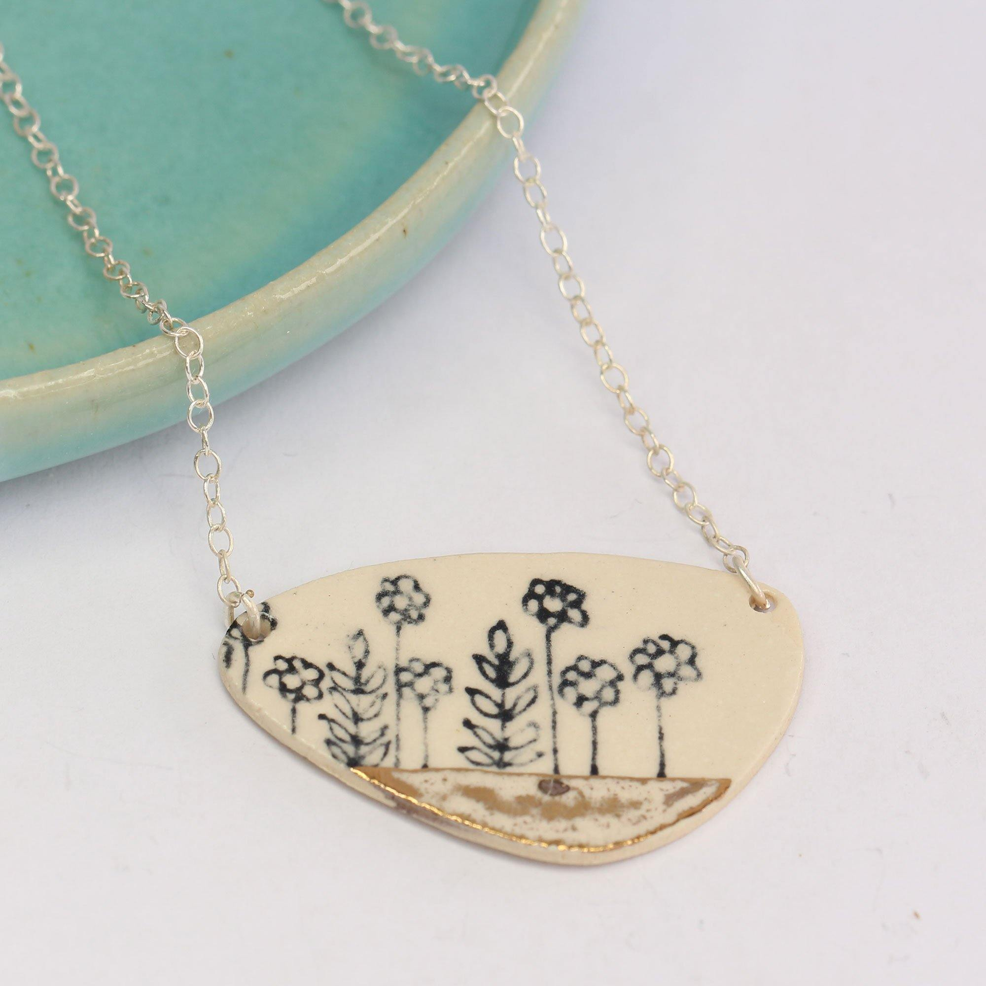 https://cdn.shopify.com/s/files/1/1295/5281/products/a-florals-necklace.jpg?v=1623179582