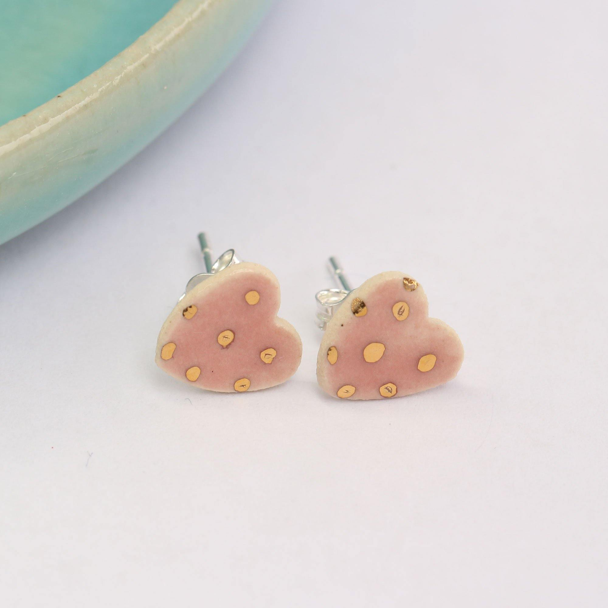 Pink Dotty Ceramic Heart Studs With Gold Lustre Details by  Insideout