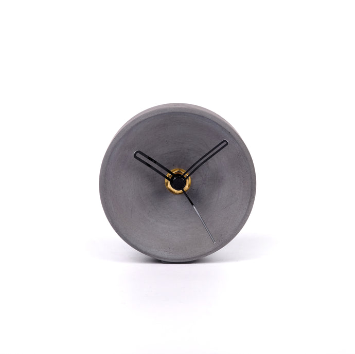 Concrete clock on desk - small concave in dark grey