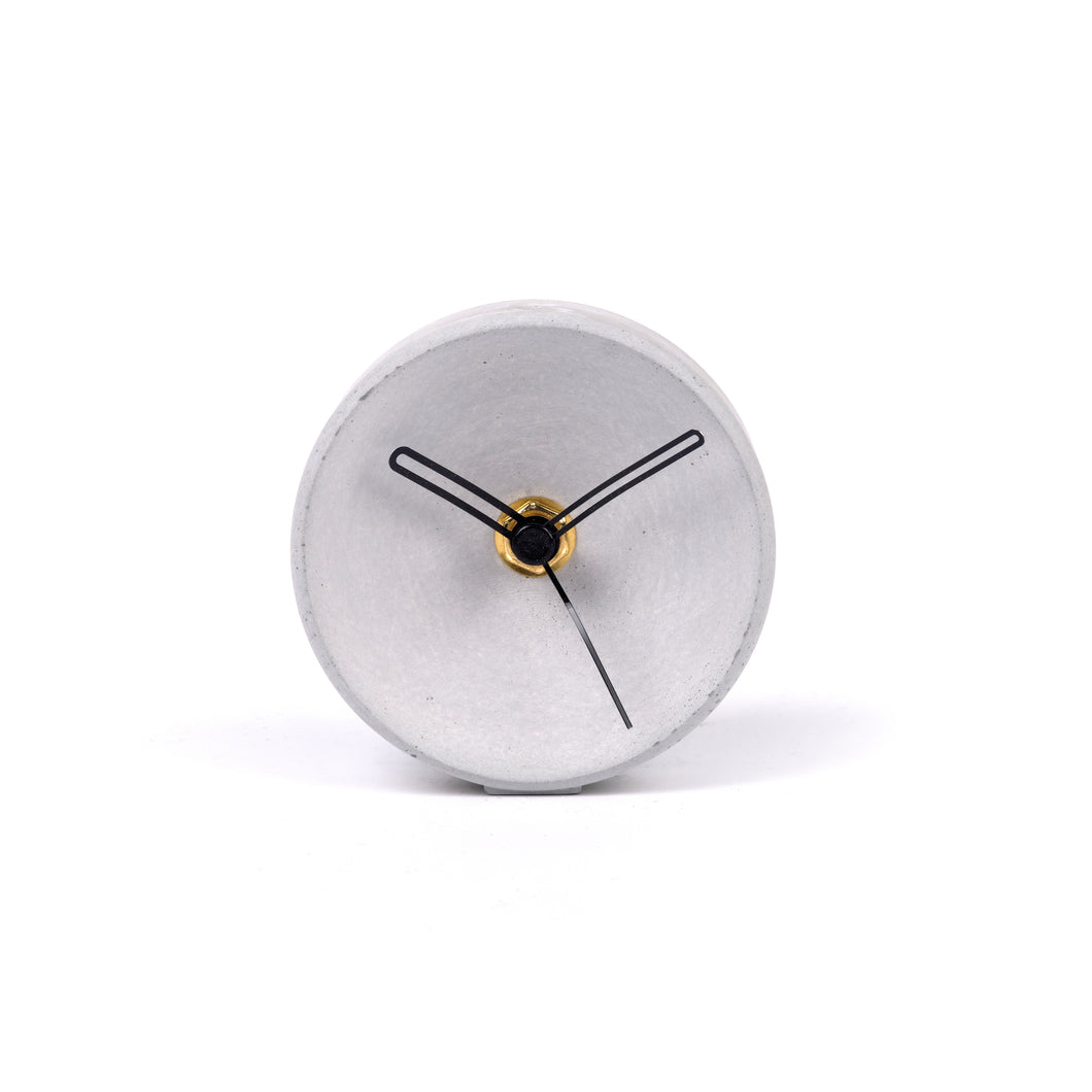Concrete clock on desk - small concave in grey