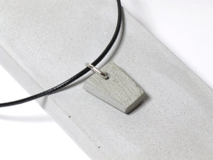 Black nylon necklace with hand sanded & polished concrete pendant (RT-001)