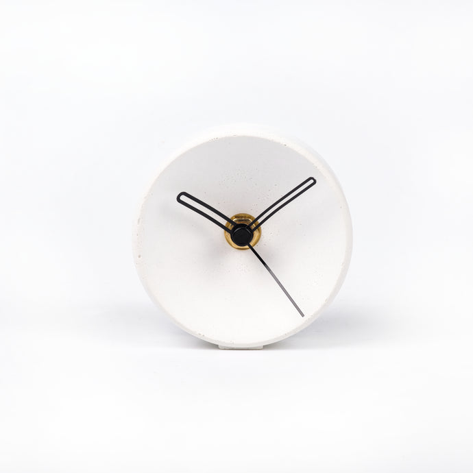 Concrete clock on desk - small concave in white