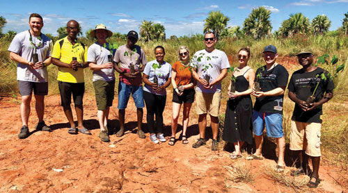 Zippo employees in Madagascar with local tree planting crew