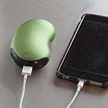 Image showing Green 6-Hour Hand Warmer charging a cell phone