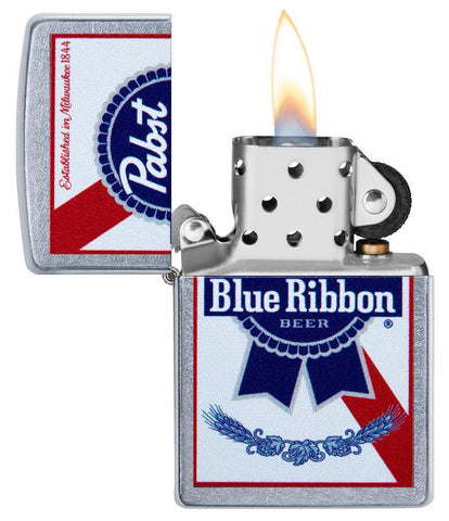 Pabst Blue Ribbon windproof lighter with its lid open and lit