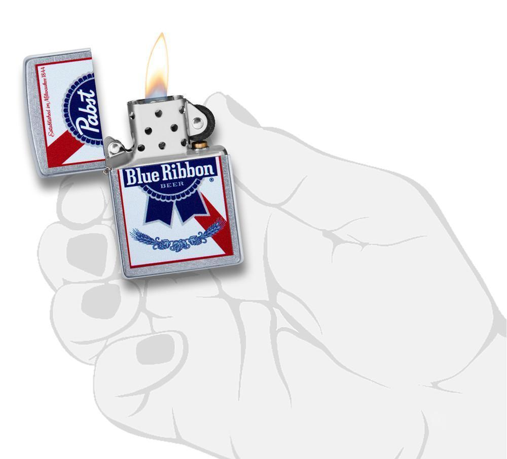 Pabst Blue Ribbon windproof lighter lit in hand