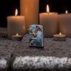 Lifestyle image of Anne Stokes Colorful Dragons Lighter standing on cobblestone with lit candles in the background