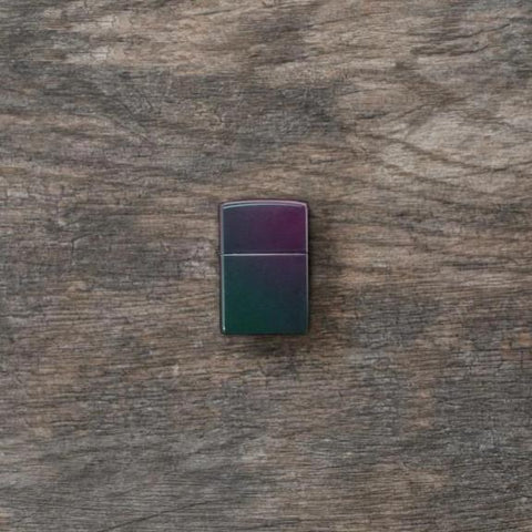 Iridescent windproof lighter facing forward at a 3/4 angle