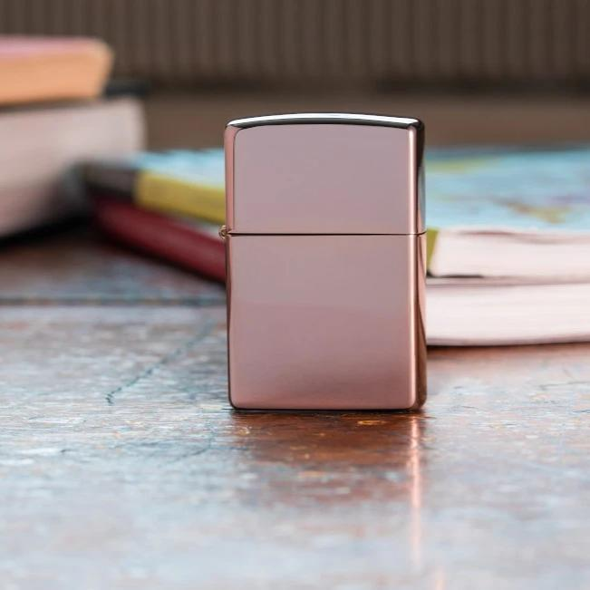 Lifestyle image of High Polish Rose Gold standing on a desk with books in the background