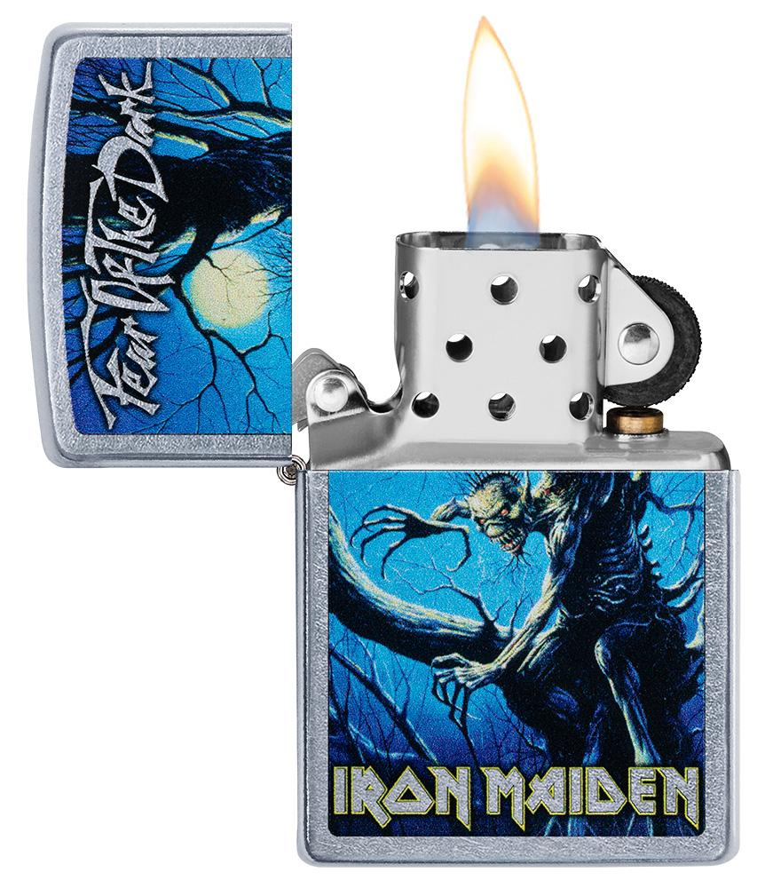 Iron Maiden Fear of the Dark Windproof Lighter with its lid open and lit