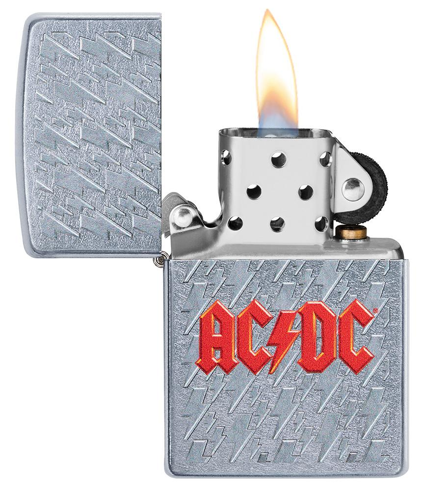 AC/DC Lightning Logo Windproof Lighter with its lid open and lit