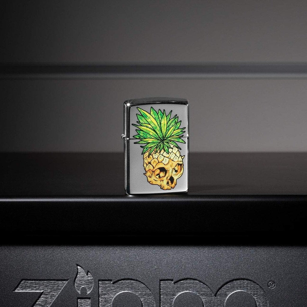 Lifestyle image of Leaf Skull Pineapple Design Windproof Lighter standing on a metal Zippo shelf
