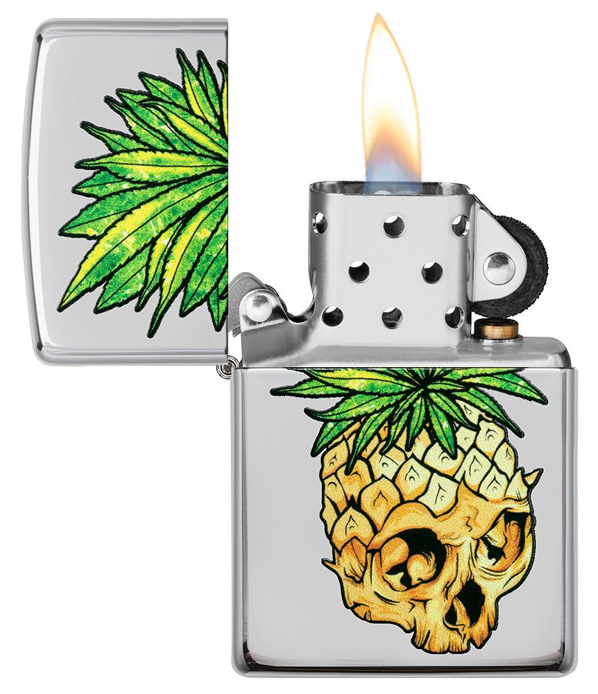 Leaf Skull Pineapple Design Windproof Lighter with its lid open and lit