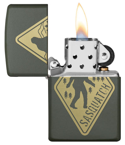 Sasquatch Crossing Windproof Lighter with its lid open and lit
