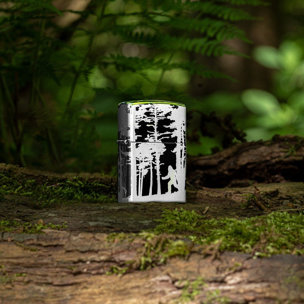 Lifestyle image of Squatchin' In The Woods 360° Design Windproof Lighter standing on a log in the woods