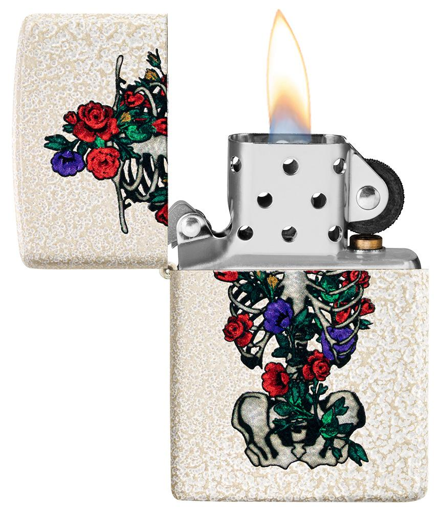Floral Skeleton Design Windproof Lighter with its lid open and lit