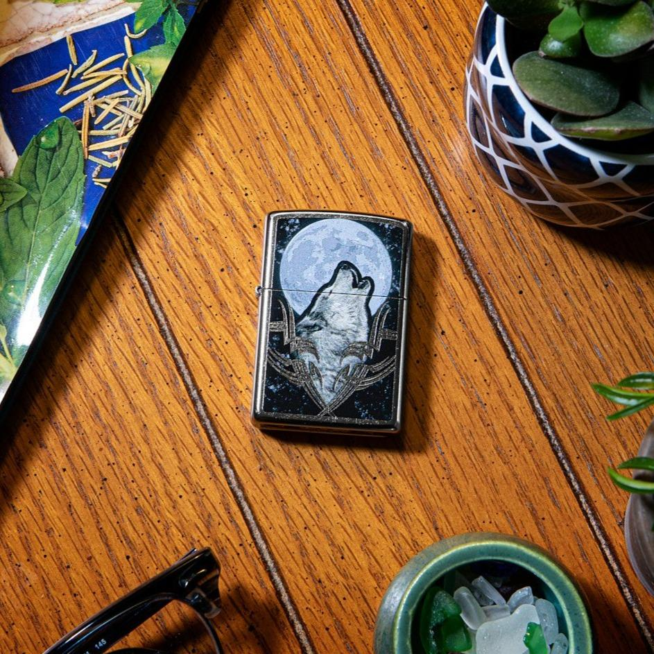 Lifestyle image of Howling Wolf Design Windproof Lighter laying on a side stand