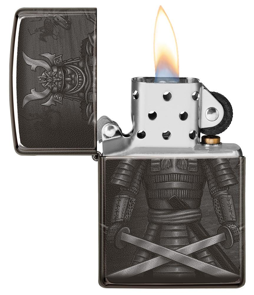 Knight Fight Design High Polish Black Windproof Lighter with its lid open and lit