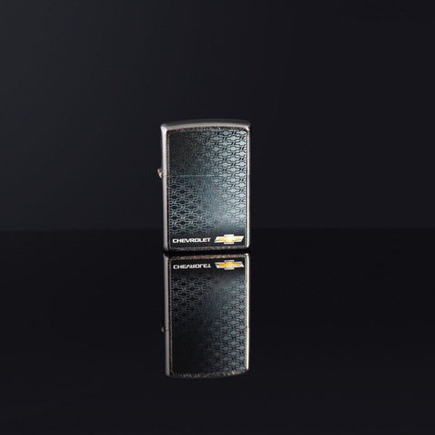 Lifestyle image of Chevrolet® Street Chrome™ Windproof Lighter standing on a black reflective background