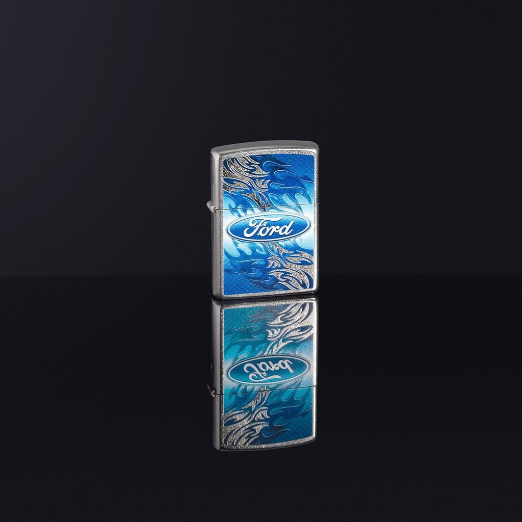 Lifestyle image of Ford Flame Logo Street Chrome™ Windproof Lighter standing in a black reflective background