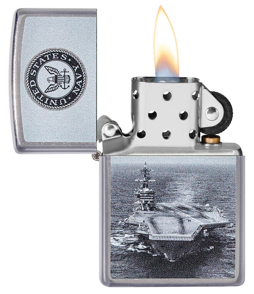 U.S. Navy® Aircraft Carrier Street Chrome™ Windproof Lighter with its lid open and lit