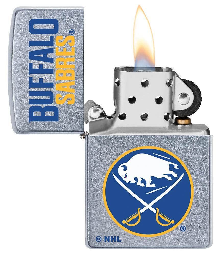©NHL Buffalo Sabres Street Chrome™ Windproof Lighter with its lid open and lit