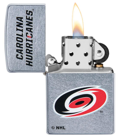 ©NHL Carolina Hurricanes Street Chrome™ Windproof Lighter with its lid open and lit