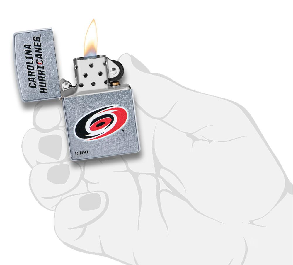 ©NHL Carolina Hurricanes Street Chrome™ Windproof Lighter lit in hand