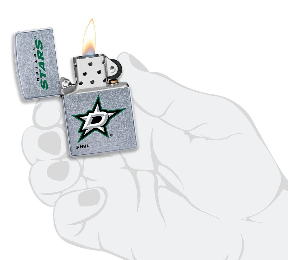 ©NHL Dallas Stars Street Chrome™ Windproof Lighter lit in hand