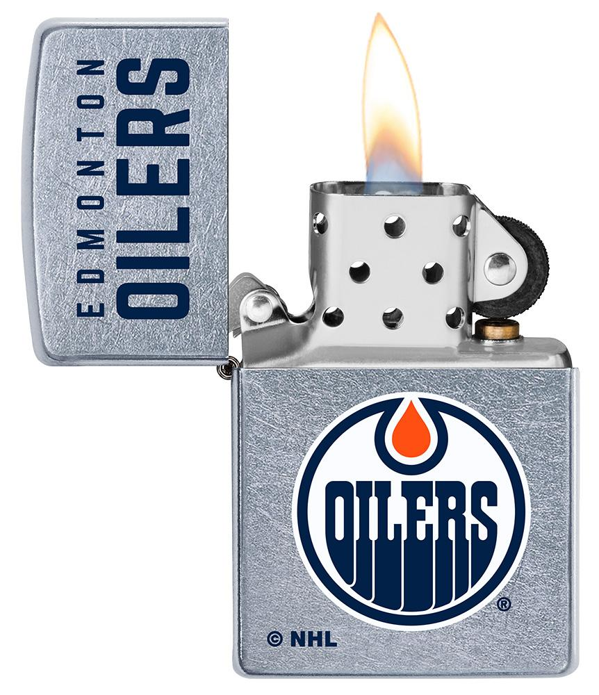 ©NHL Edmonton Oilers Street Chrome™ Windproof Lighter with its lid open and lit