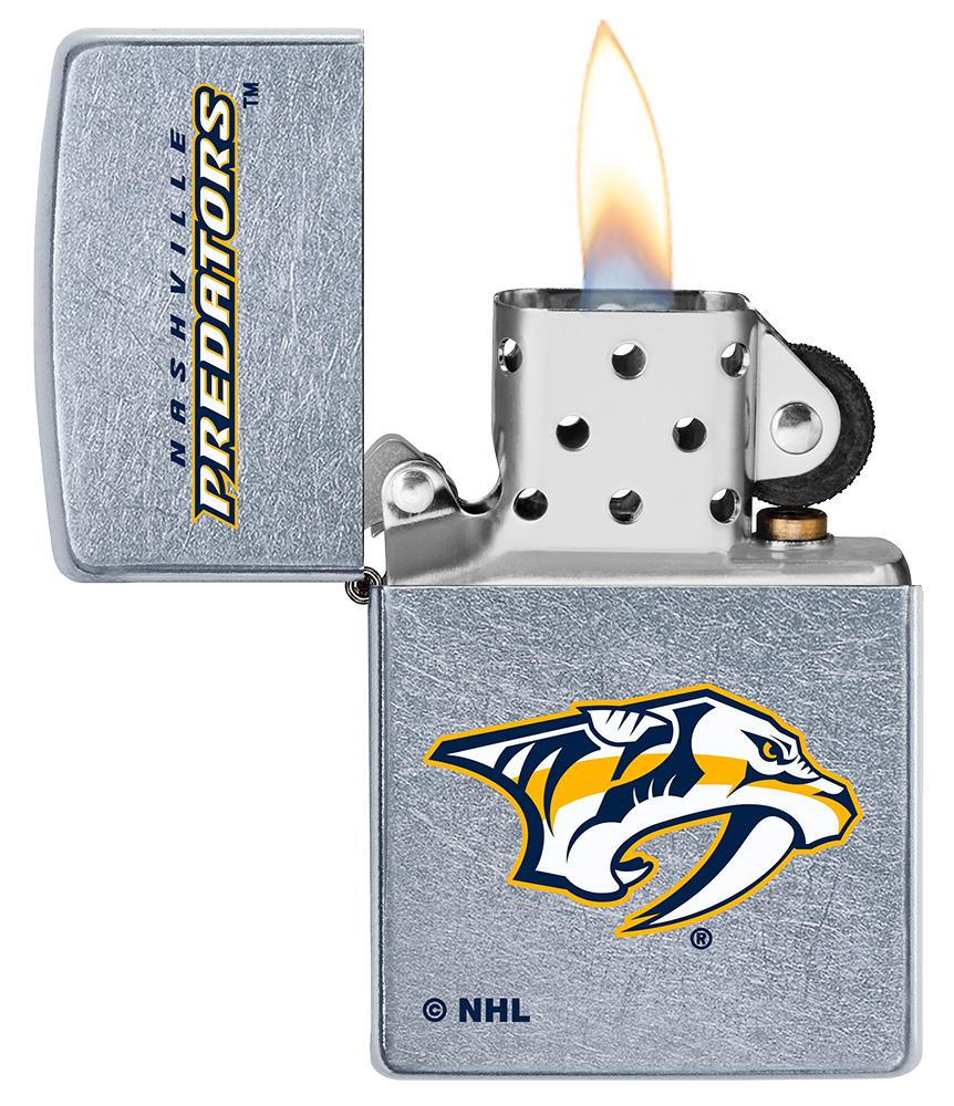 ©NHL Nashville Predators Street Chrome™ Windproof Lighter with its lid open and lit