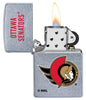 NHL® Ottawa Senators® Street Chrome™ Windproof Lighter with the lighters lid open and lit
