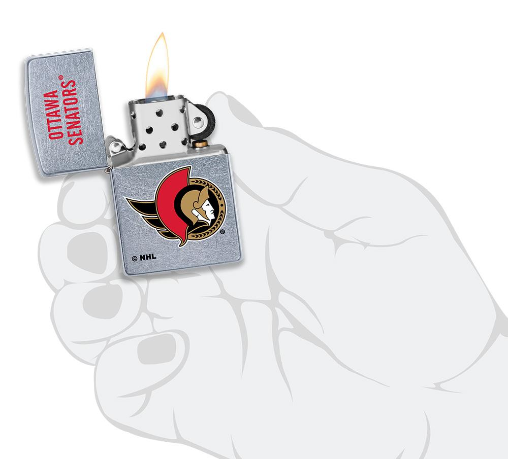 NHL® Ottawa Senators® Street Chrome™ Windproof Lighter lit in hand
