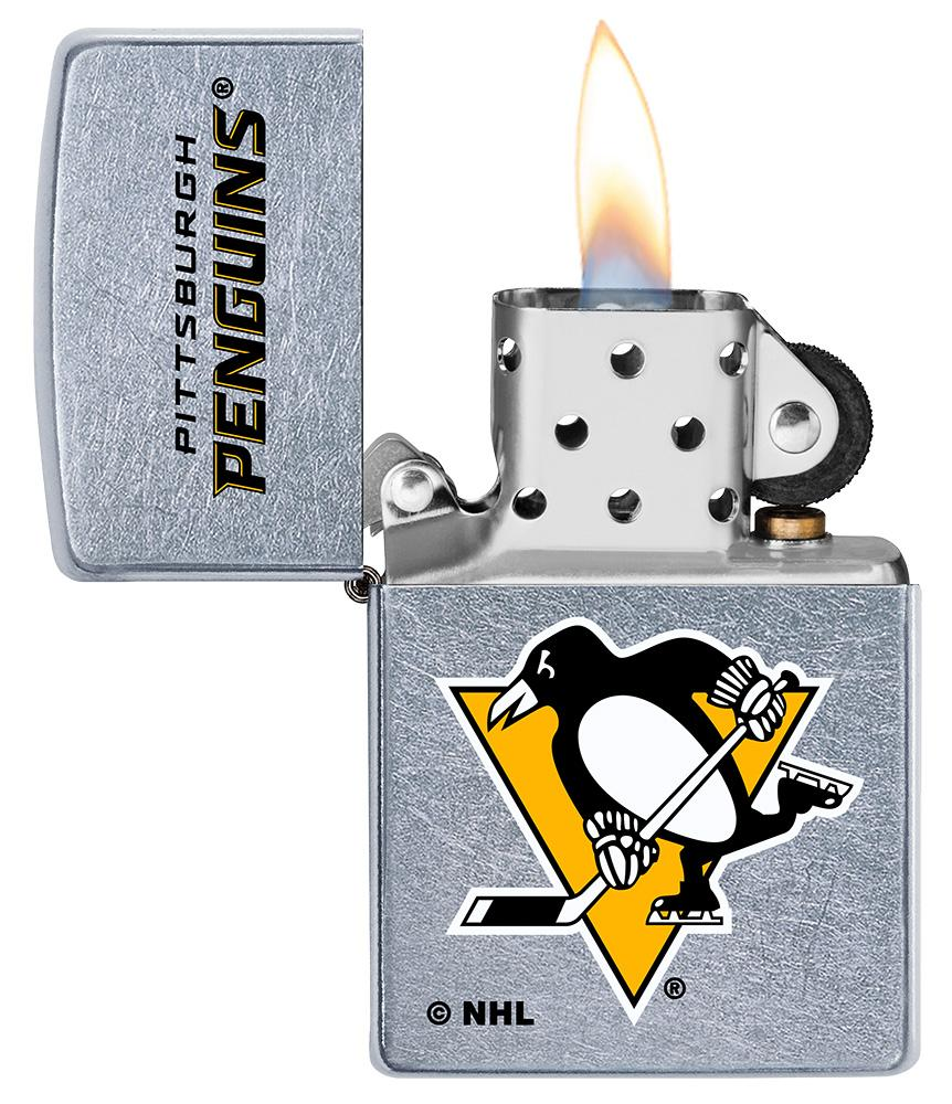 ©NHL Pittsburgh Penguins Street Chrome™ Windproof Lighter with its lid open and lit